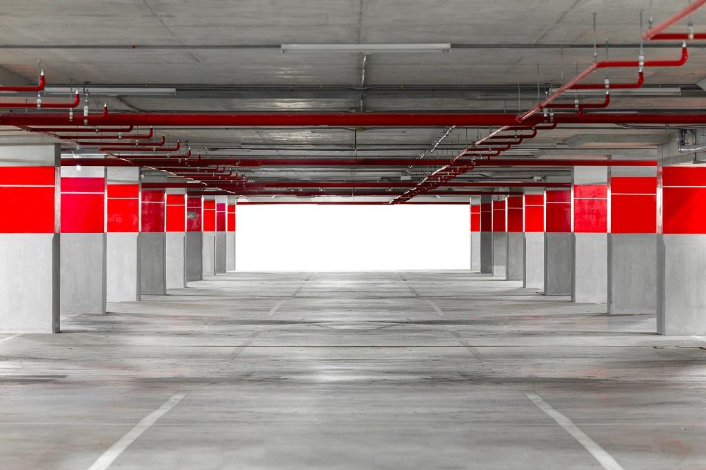 Parking Garage Underground Interior With Blank Billboard.