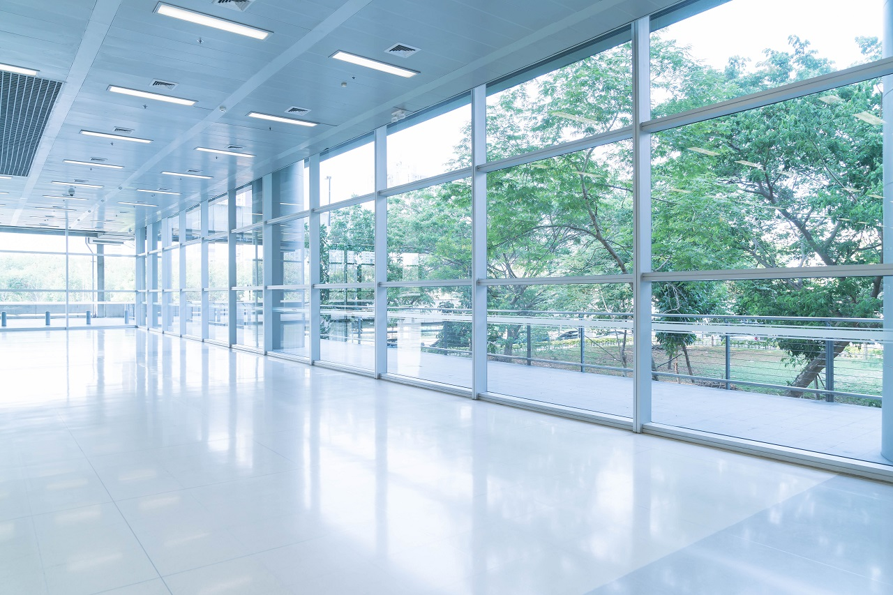 Why is polished concrete ideal for school flooring?