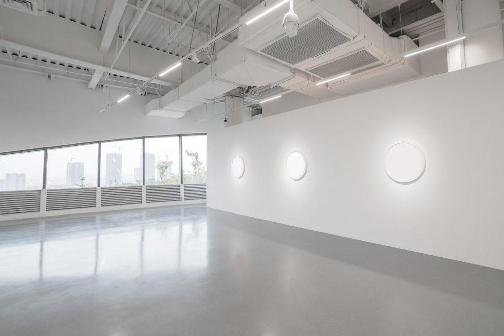 Wide view of a metallic epoxy floor of an empty museum