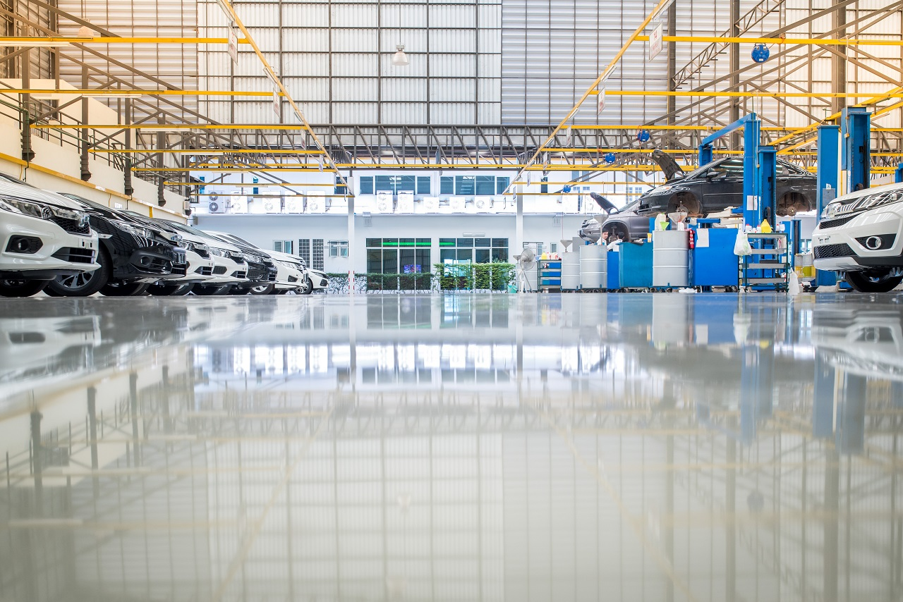 Low angle picture of metallic epoxy flooring in a auto repair shop