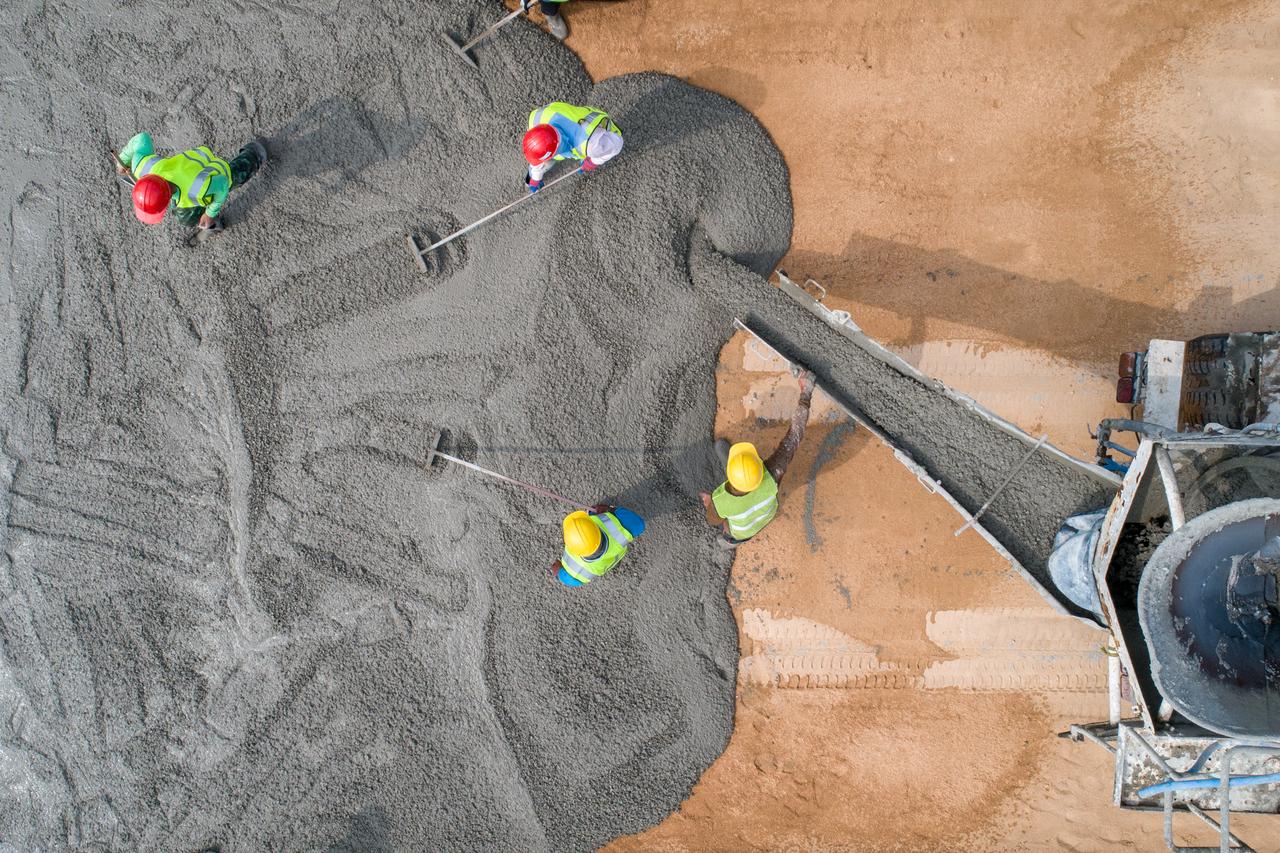 A construction team forming a concrete floor