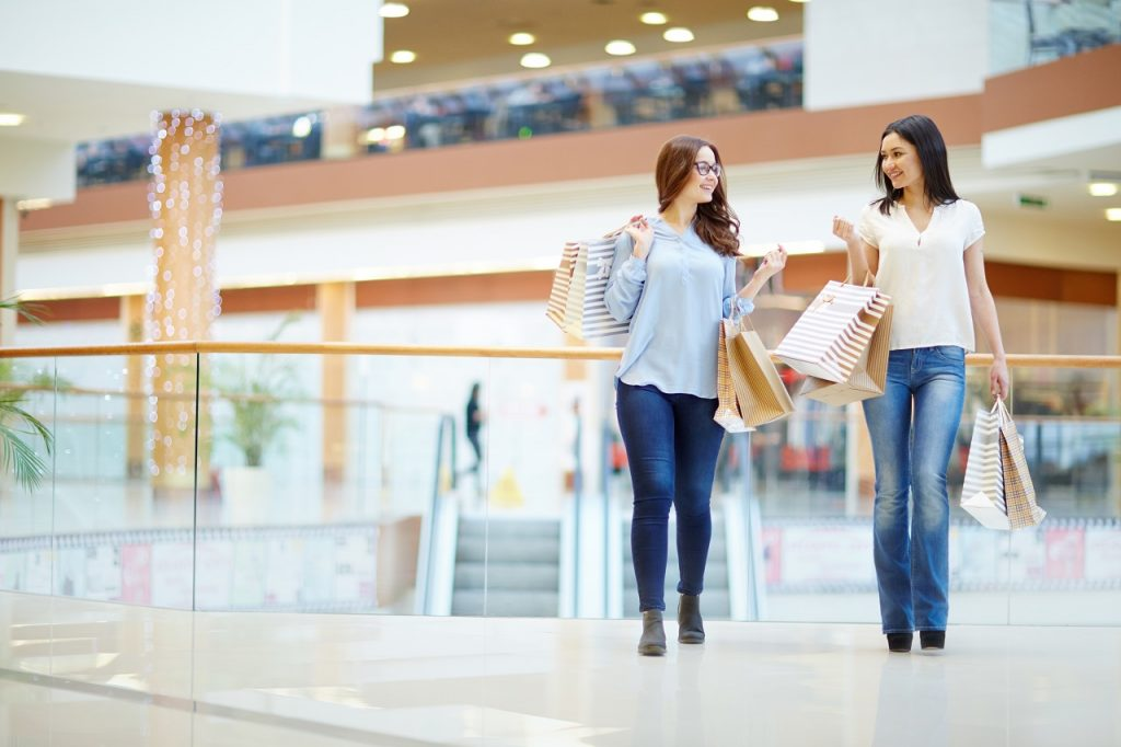 Two women talking at a shopping mall