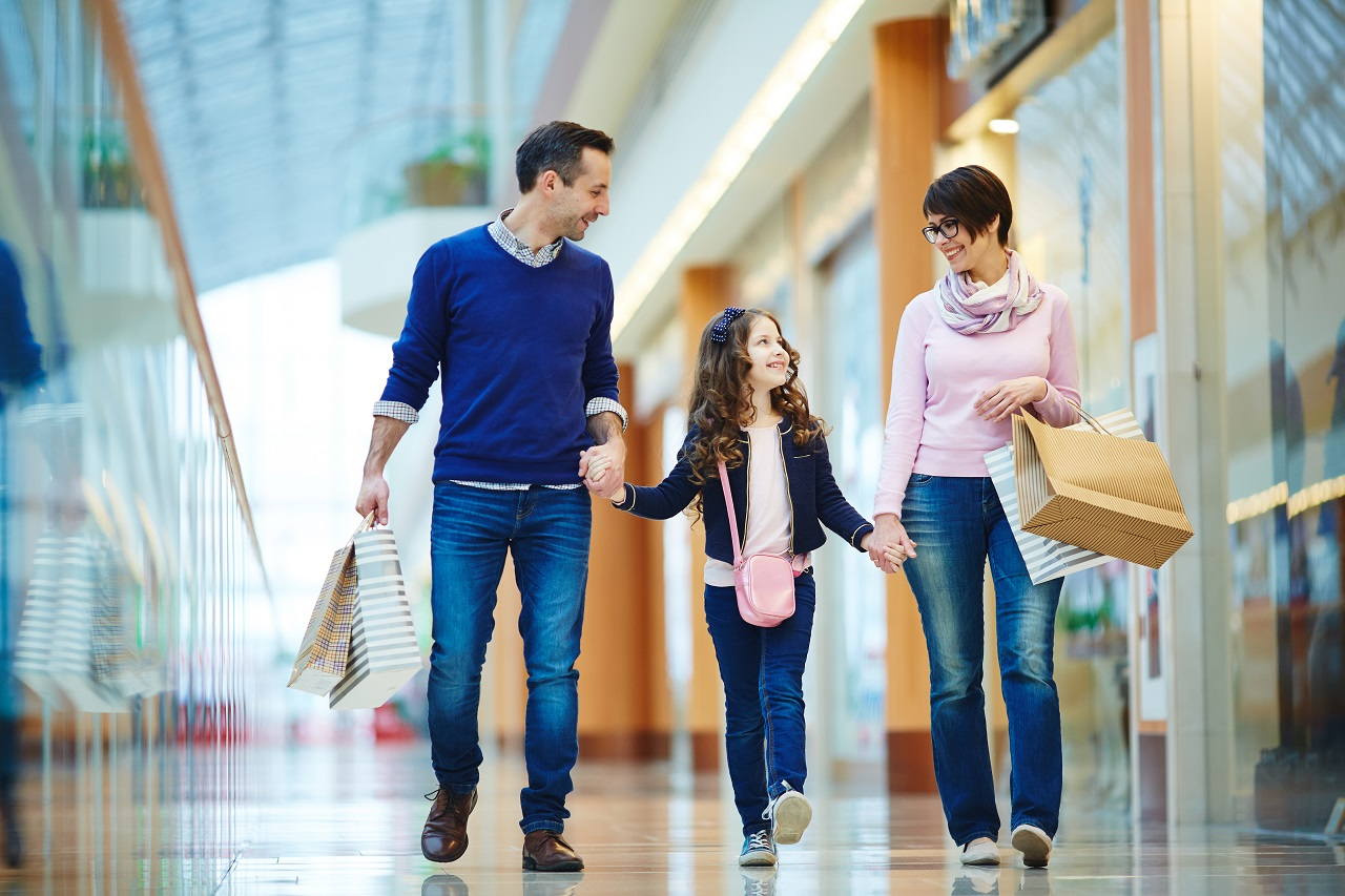 Parents and their daughter going shopping
