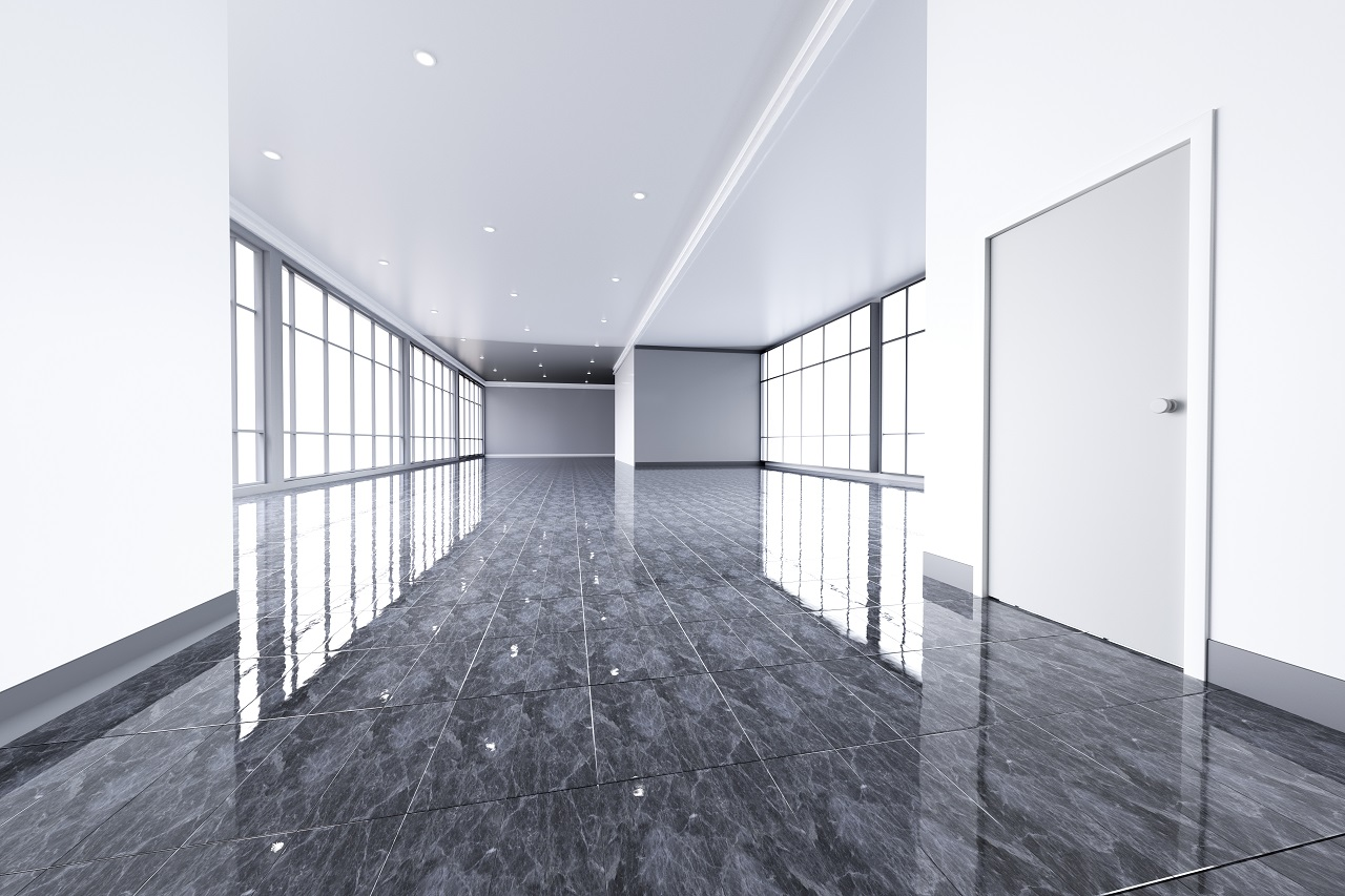 An empty office space with metallic epoxy flooring