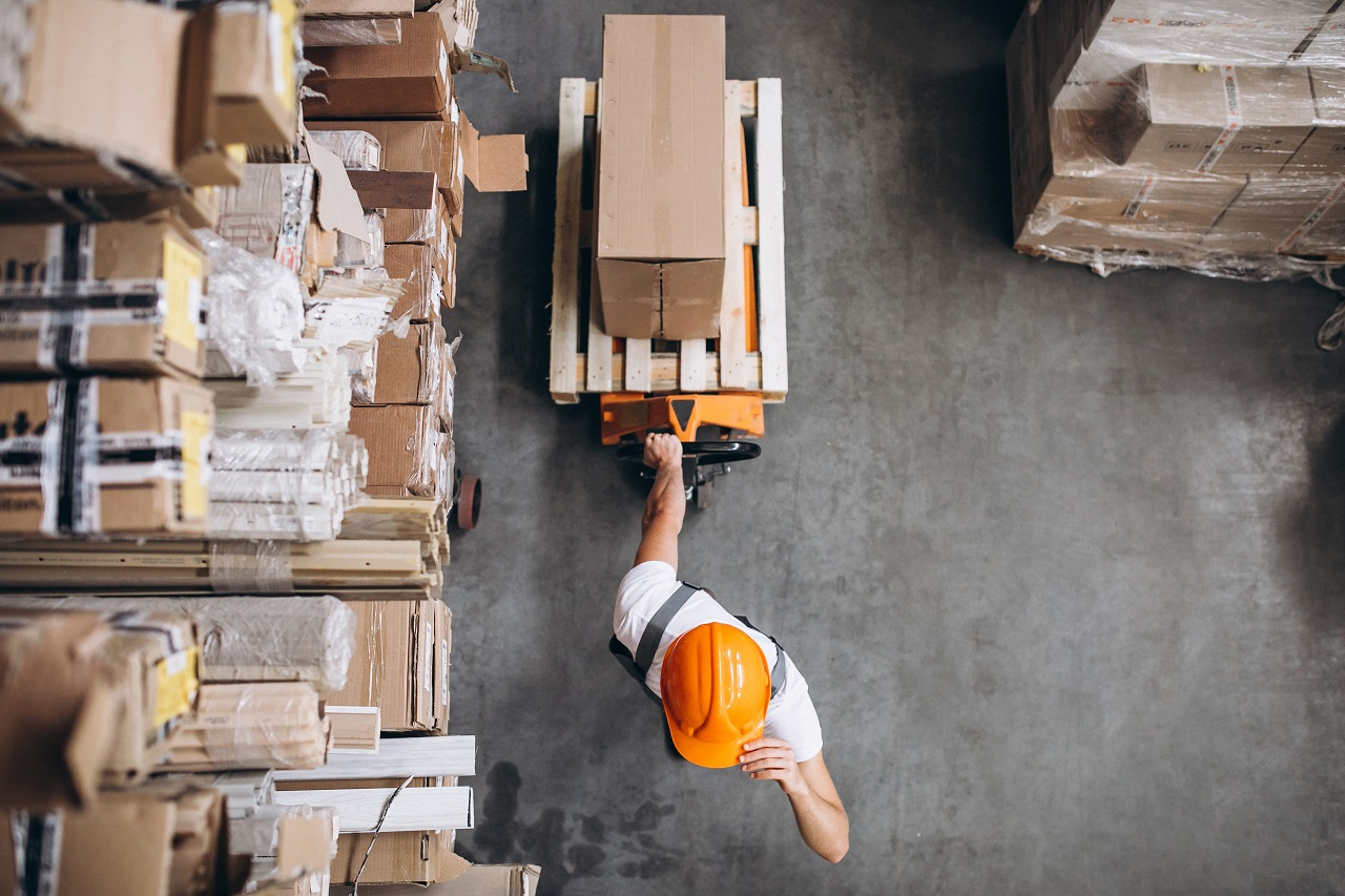 A worker pulling boxes in a warehouse