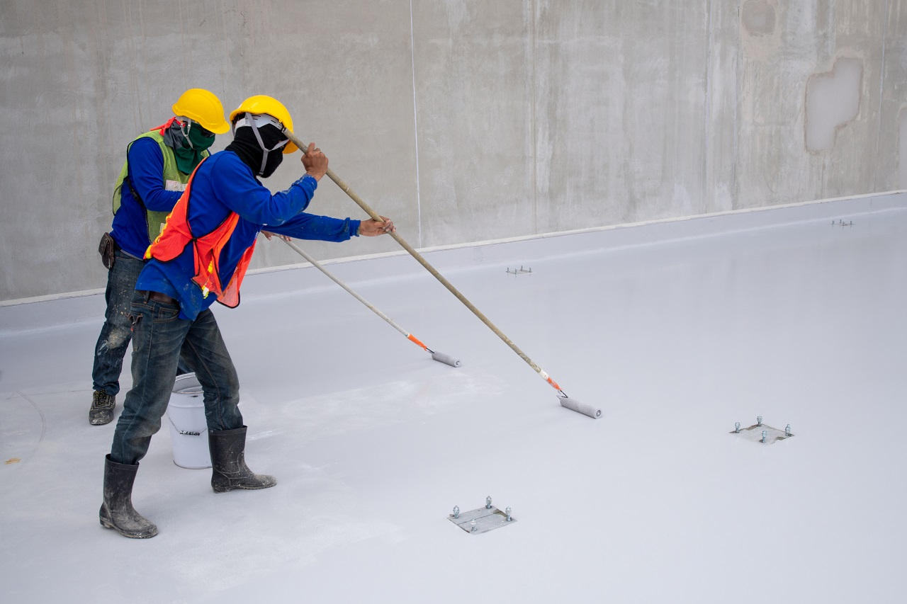 Construction workers creating epoxy flooring
