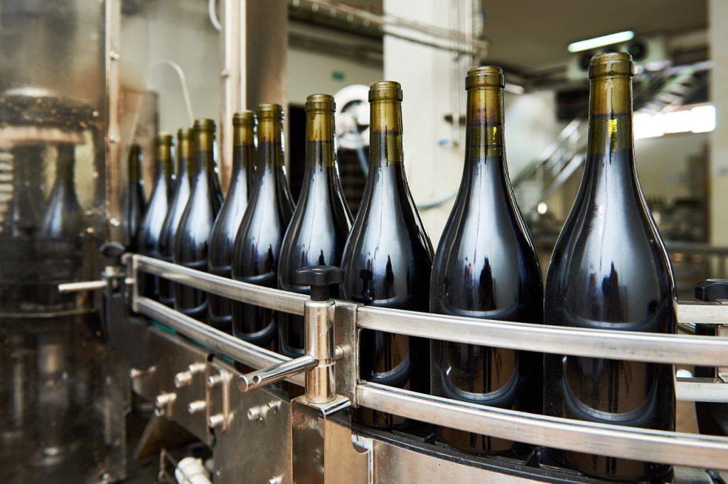 Bottling glass wine bottles at a factory