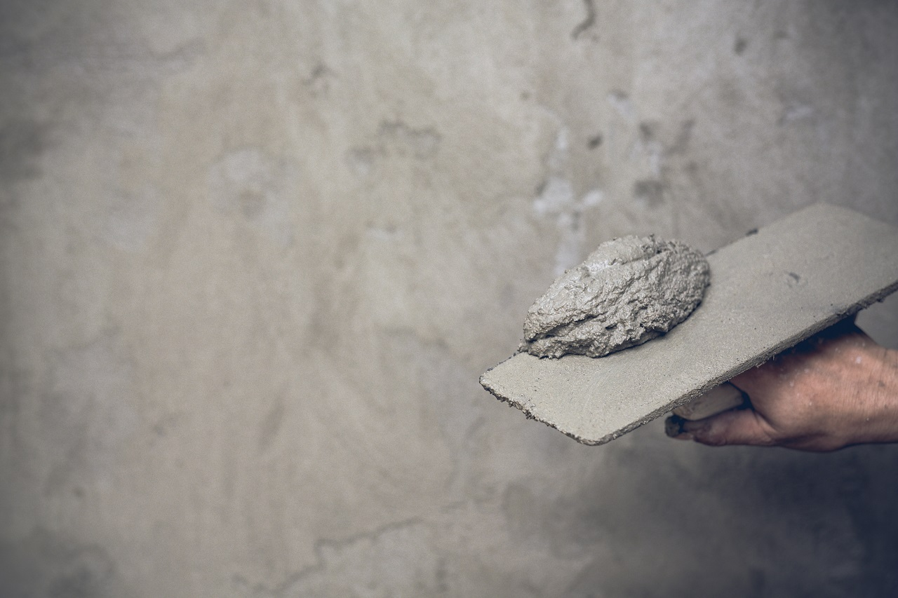 A plasterer making a concrete floor