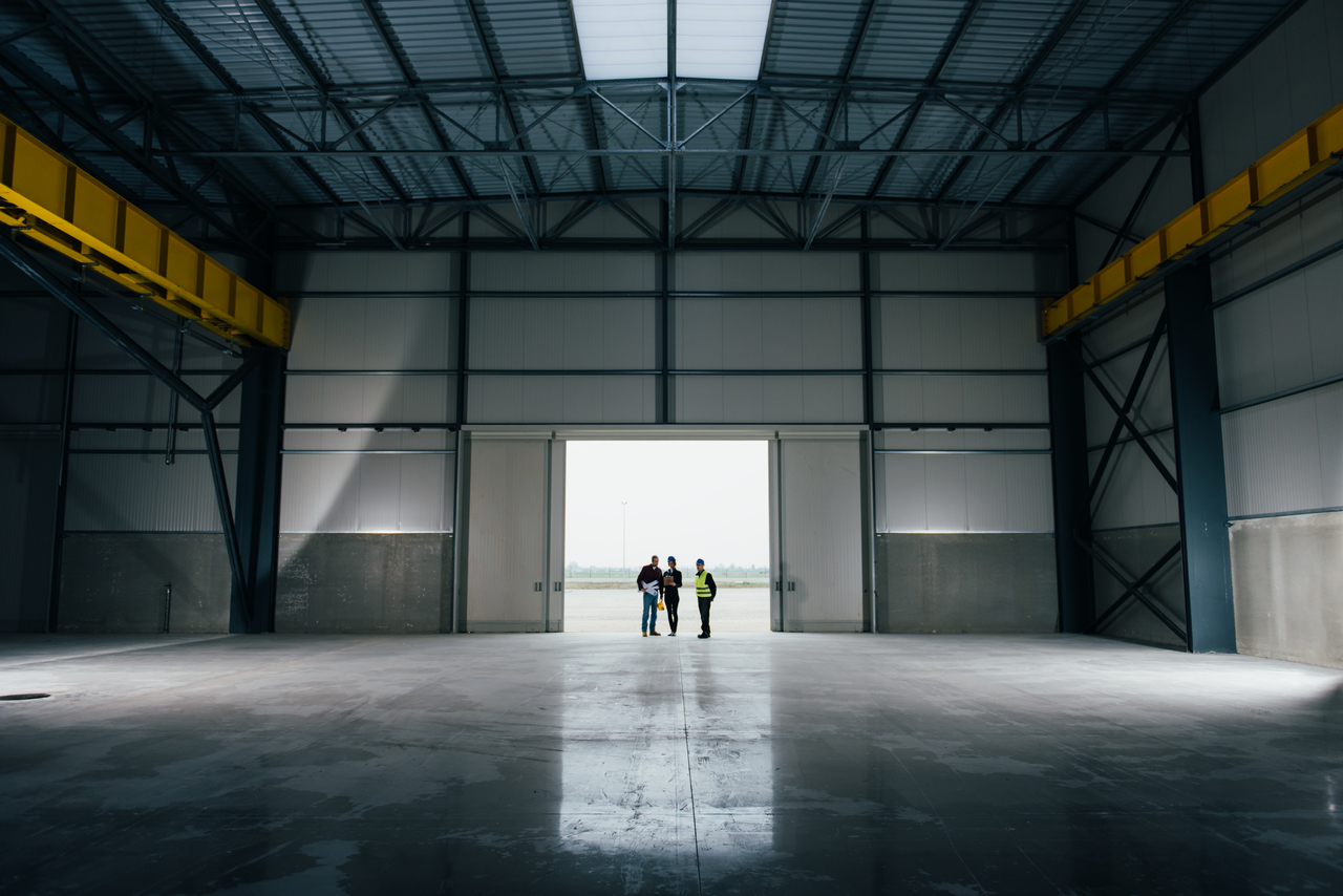 A team inspecting concrete warehouse flooring