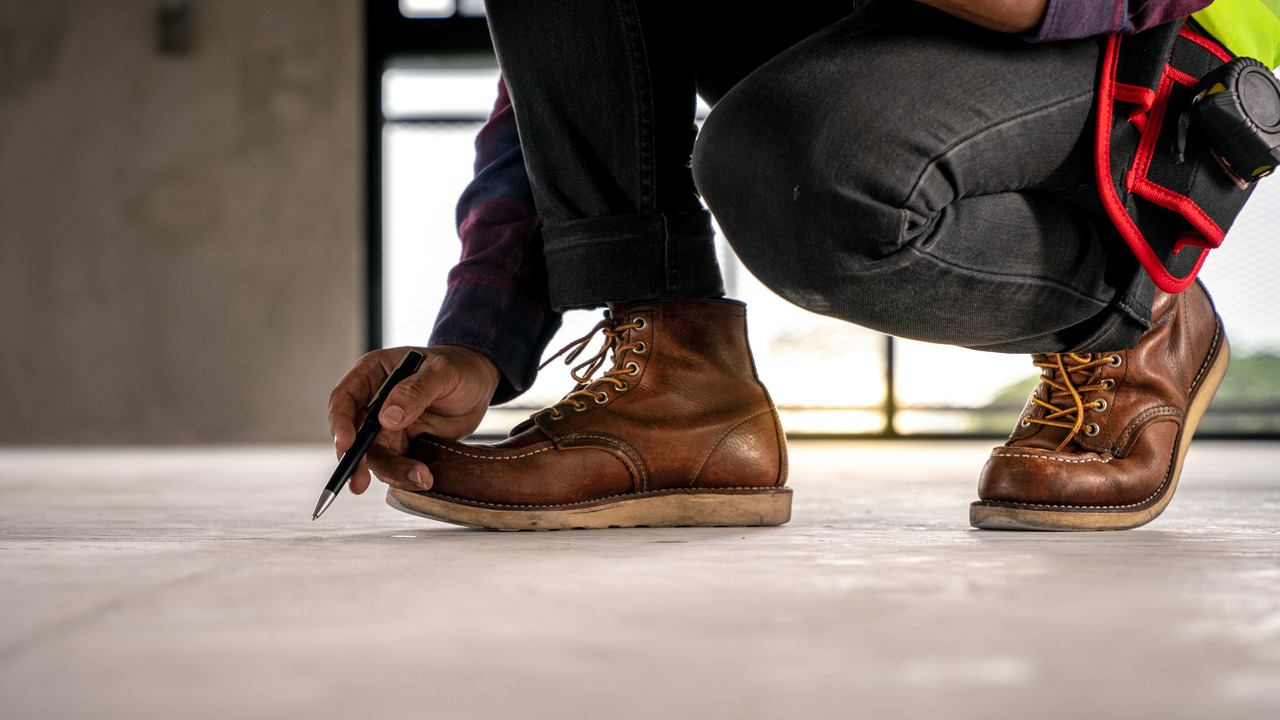 An employee of Flooring Solutions checking the floor