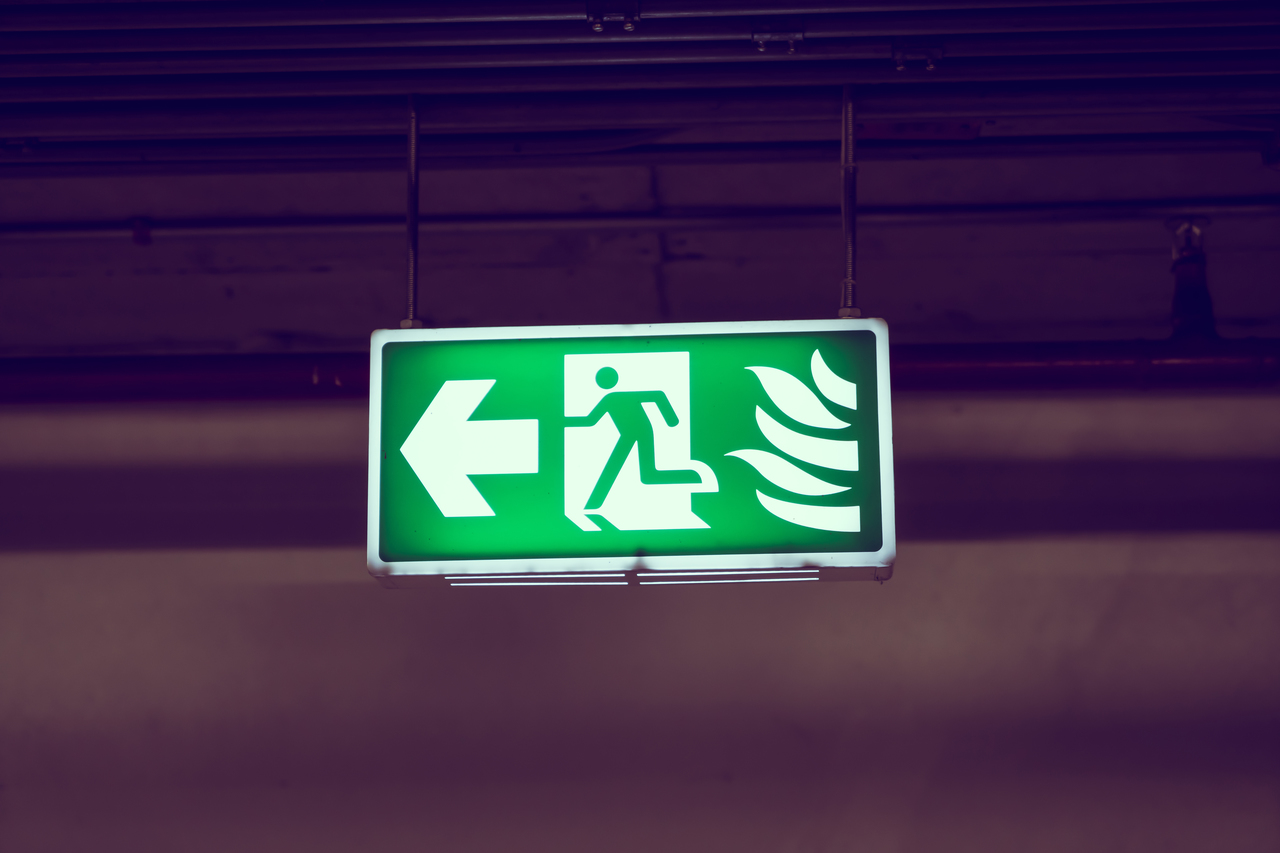 A glowing fire exit sign