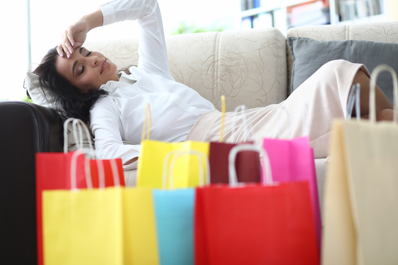 A woman feeling unwell after shopping at a mall